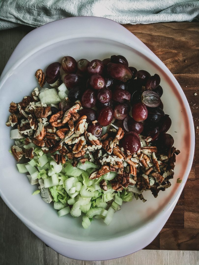 I love this chicken salad. The nuttiness of pecans with the sweet grapes is so yummy. I always add extra celery because I like that crunch factor. This chicken pecan salad was a regular item on our menu and in our deli case at my restaurant.